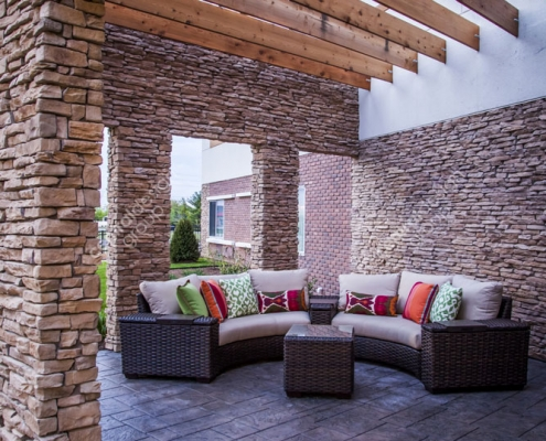 St. Peters Hotel Exterior Design with Patio Furniture and Decorative Pillows