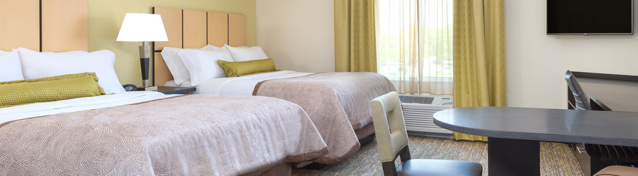 Hotel Interior Design with Green Accent Pillows